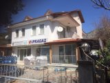 Excellent property with 2 shops and 2 apartments