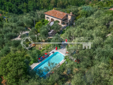 Stone farmhouse with pool for sale on the hills of Versilia, Tuscany